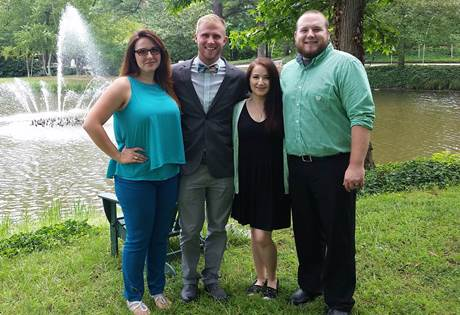 Student council members, Treasurer Jennie Alexander, President Brent Money, Secretary Jen Germano, Vice President Zane Gray