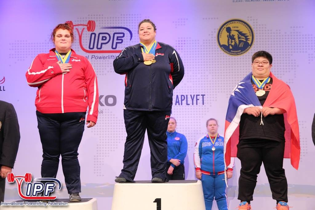 Life University Assistant Director of the Wellness Center, Becci Holcomb, is shown here on the far right on the podium earning 2nd place overall at the IPF World Championships for powerlifting.