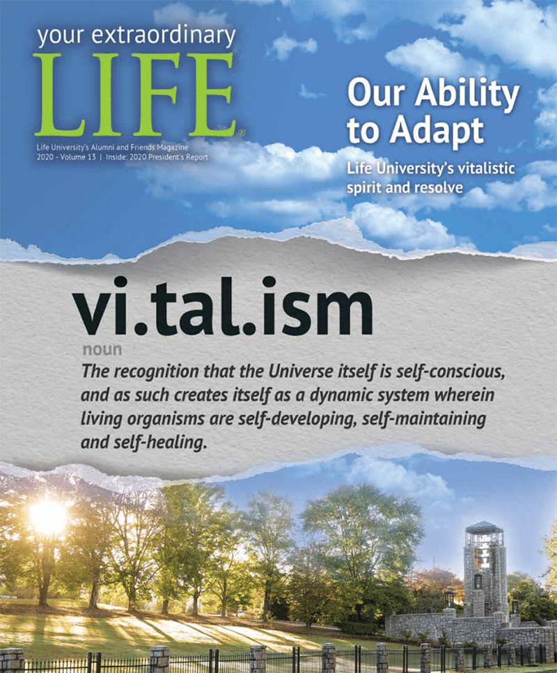 This is a picture of the cover of Life University's annual alumni and friends magazine. It features an image of Life University's Bell Tower and campus greens. There is a message in the center with LIFE's philosophy of Vitalism defined as it relates to the 2020 issue theme of LIFE's ability to adapt.